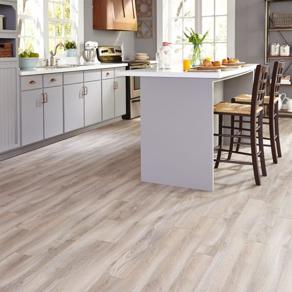 Delaware Bay Driftwood Laminate Flooring in Kitchen and Sunroom