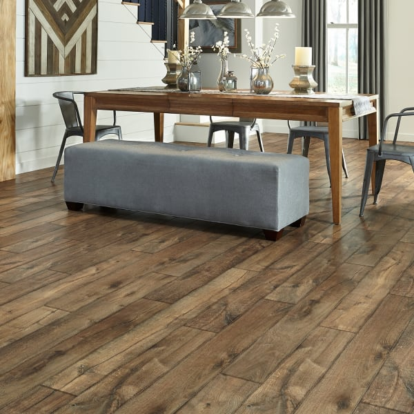 Antique Farmhouse Hickory Laminate Flooring in dining and living room