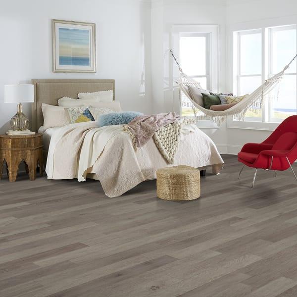 Island Sands Oak Luxury Vinyl Plank Flooring in Bedroom and Living Room