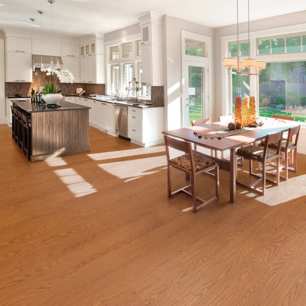 Butterscotch Oak Luxury Vinyl Plank Flooring in Kitchen and Dining Room