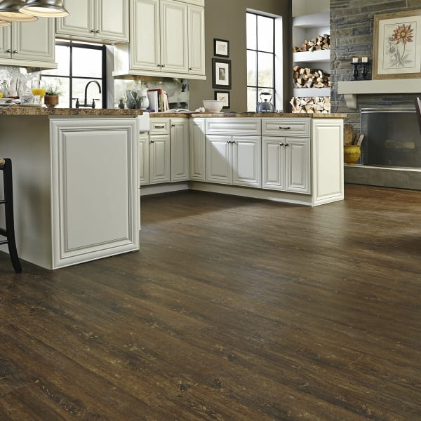 Clear Lake Chestnut Luxury Vinyl Plank Flooring in Dining Room and Kitchen