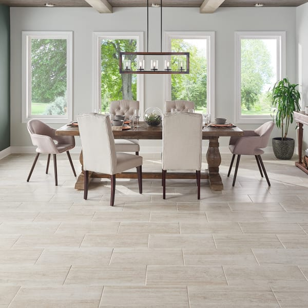 Graystone Travertine Porcelain Tile in Living Room and Dining Room