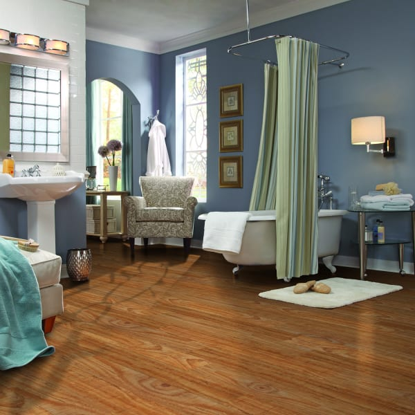 Sun Valley Pine Luxury Vinyl Plank Flooring in Bathroom and Bedroom
