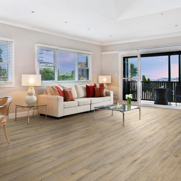 Country Bluff Oak Engineered Vinyl Plank Flooring in living room and on patio