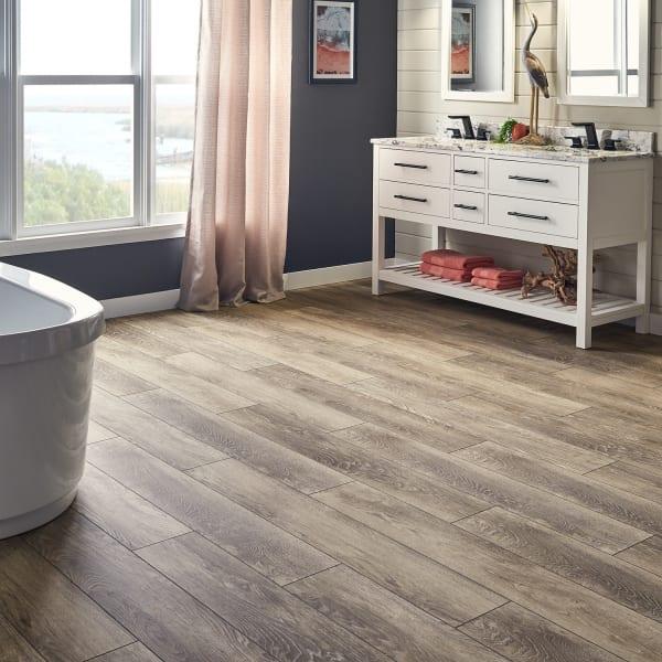 Brown Owl Oak Laminate Flooring in Bathroom