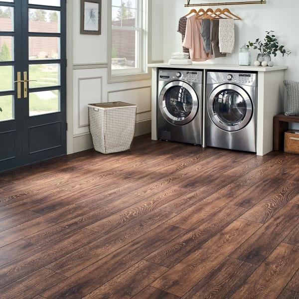 Elusive Brown Oak Laminate Flooring in Playroom and Mudroom