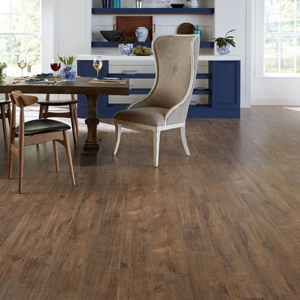 Copper Sands Oak Laminate Flooring in dining room and kitchen
