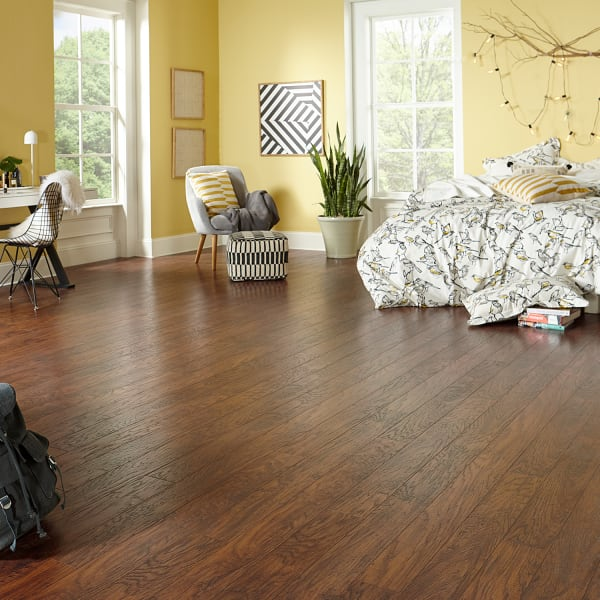 Amber Hickory Laminate Flooring in Bedroom and Living Room