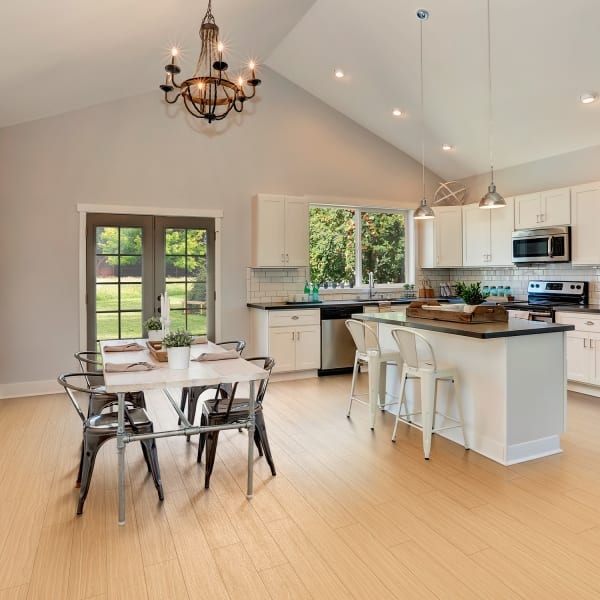 Heartland Red Oak Engineered Vinyl Plank Flooring in Kitchen, Dining Room, and Playroom
