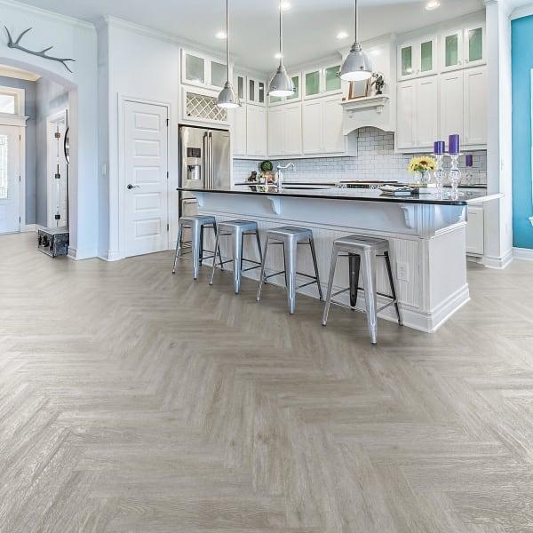 Citadel Gray Oak Engineered Vinyl Plank Flooring in Living Room, Bedroom, and Kitchen