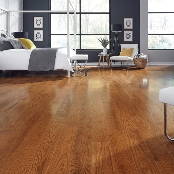 .75 in. x 5 in. Saddle Oak Solid Hardwood Flooring in Rustic Traditional Bedroom