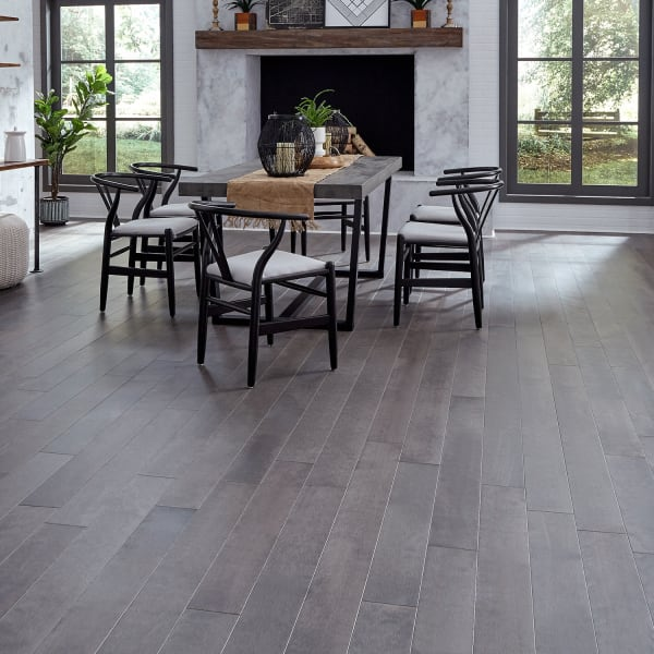 .75 in. x 5 .25 in. Pasque Island Distressed Gray Solid Hardwood Flooring in Industrial Dining Room