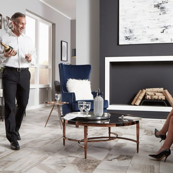 Costa Bella Marble Porcelain Tile in Living Room with Couple
