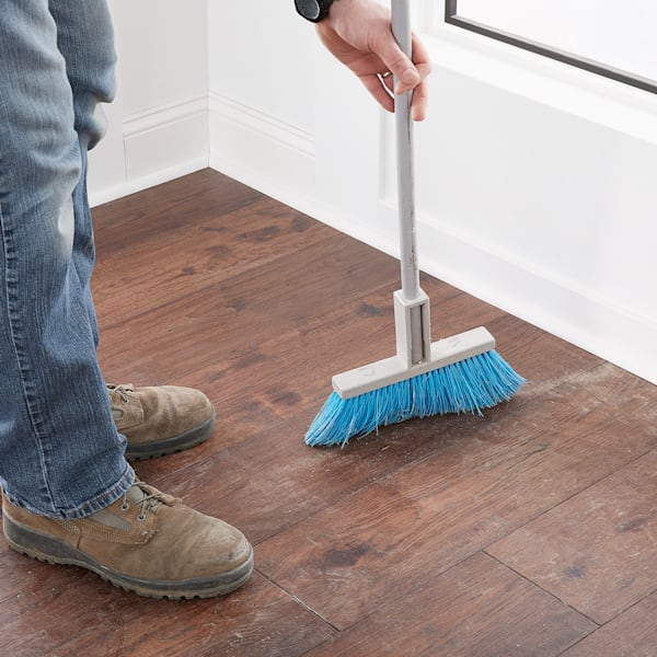 installer sweeping finished installation
